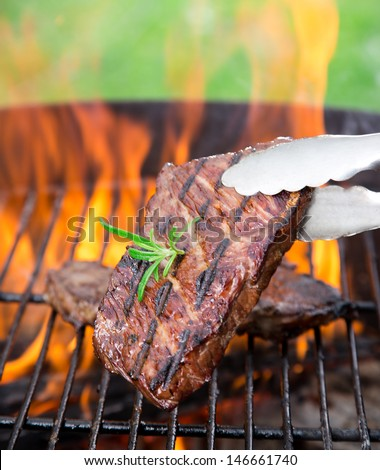 closeup of steak on a grill - stock photo