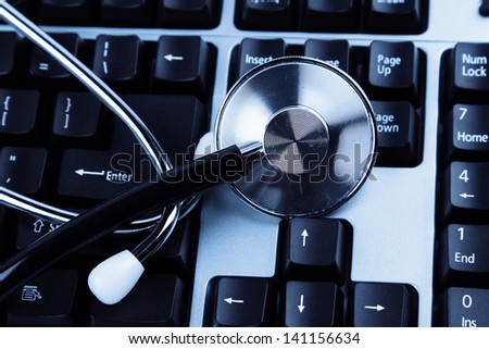 Closeup of stethoscope on keyboard