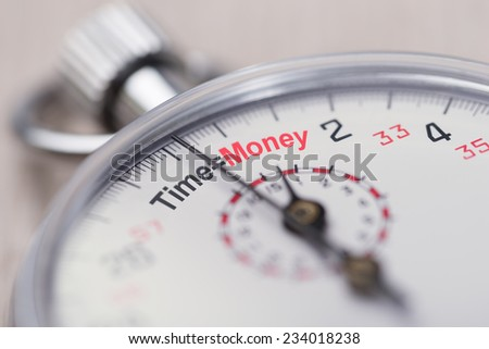 Closeup of stopwatch showing Time equals Money sign - stock photo