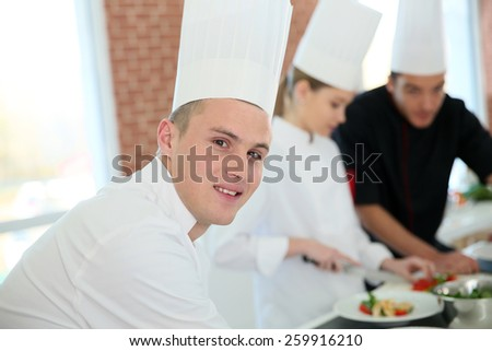 Closeup of student in catering school - stock photo