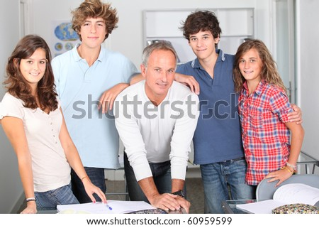 Closeup of students with teacher - stock photo