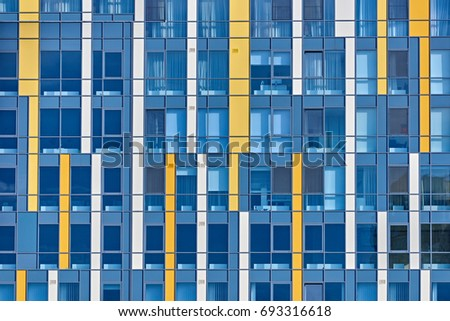 Closeup of stylish colored window's wall of modern building