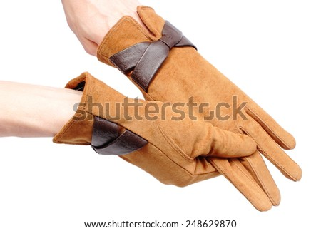 Closeup of suede gloves for woman, beautiful brown leather gloves. Isolated on white background - stock photo