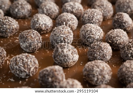 Closeup of sweet Indian coconut burfi treats with selective focus - stock photo