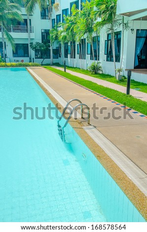 Closeup of swimming pool with staircase at hotel