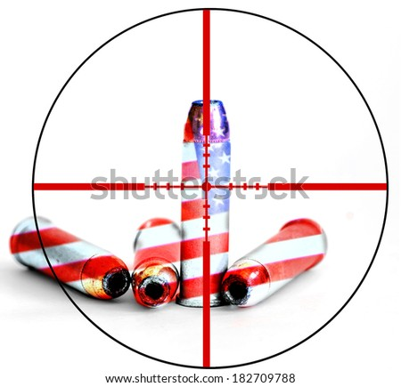 Closeup of tactical military bullets with crosshairs for opposition to gun freedom and second amendment rights - stock photo