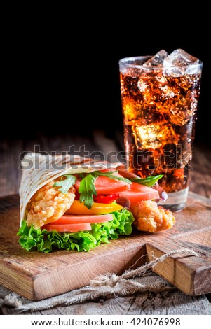 Closeup of tasty kebab with chicken and vegetables - stock photo