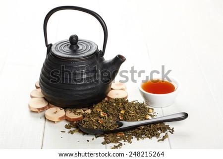 Closeup of tea set on table - stock photo