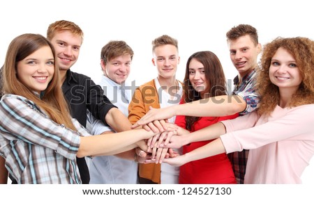 Closeup of team putting their hands on top of each other - stock photo