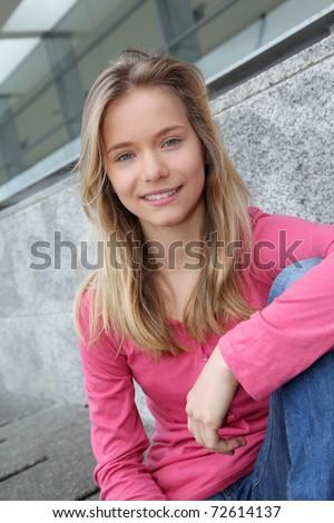 Closeup of teenage girl sitting on a school bench