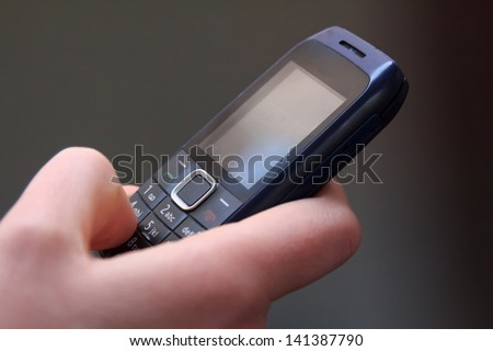 Closeup of texting on an old cell phone - stock photo