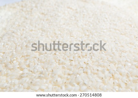 Closeup of texture background with raw rice