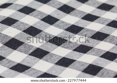 Closeup of Texture red tartan plaid textile fabric for background