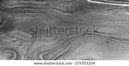 Closeup of the abstract patterns or ripple effects created in the steel due to the folding process in a Damascus blade - stock photo