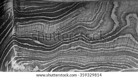 Closeup of the abstract wave patterns created in the steel due to the folding process in a Damascus blade - stock photo