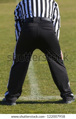 Closeup of the back of a football referee - stock photo