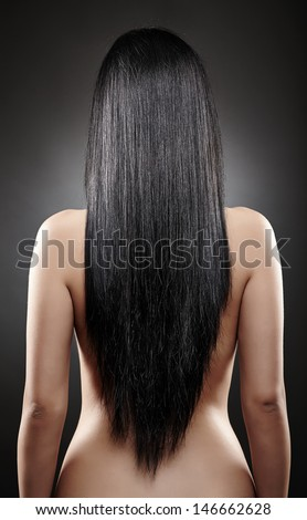 Closeup of the back of a young caucasian woman with beautiful black hair - stock photo