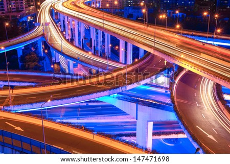 closeup of the beautiful city interchange overpass at night