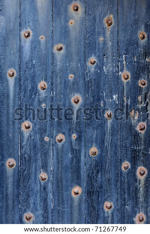 Closeup of the blue front door of the Fort Point National Historical Site in San Francisco, California