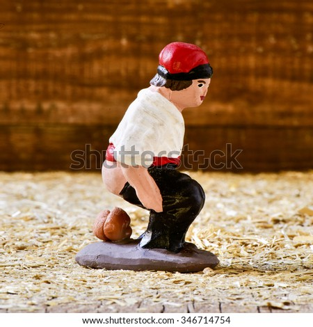 closeup of the caganer, a typical catalan character in the nativity scenes of Catalonia, Spain depicting a catalan peasant defecating