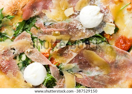 Closeup of the centre of a true Italian pizza with mozzarella, parma ham and tomatoes - stock photo