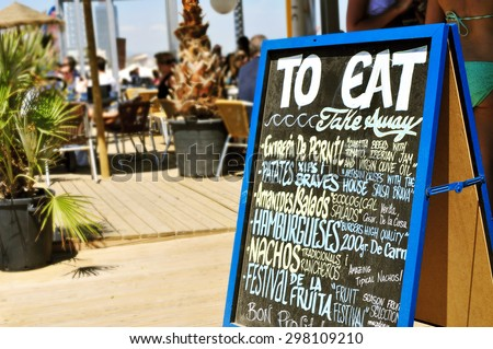 closeup of the chalkboard menu of a restaurant in Barcelona, Spain, with different catalan and spanish dishes - stock photo