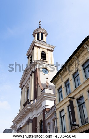 Closeup of the church tower of the St. Anthony Cathedral in Breda on a sunny summer day. The Roman Catholic church was built in 1837 and is now a national monument. - stock photo