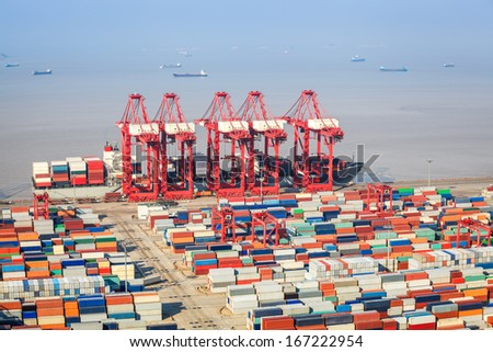 closeup of the container terminal, a busy shipping and port machinery background  - stock photo