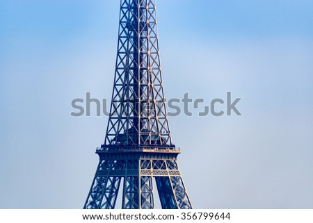 Closeup of the Eiffel Tower in Paris, France - stock photo