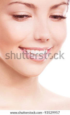 closeup of the face and healthy white teeth of a woman, isolated against white background, copyspace for your text to the right