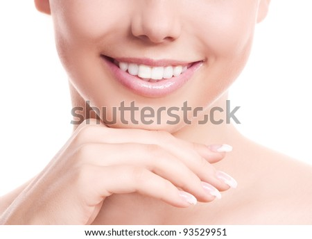 closeup of the face, hands and healthy white teeth of a woman, isolated against white background, copyspace for your text to the right