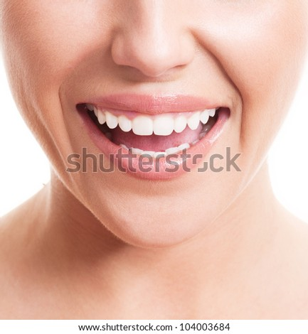 closeup of the face of a young woman with healthy white teeth, isolated against white background - stock photo