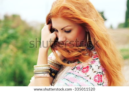 Closeup of the face with clean skin and freckles belong to beautiful young sexy red-haired girl with curly hair. Trendy, lifestyle. Bohemian fashion girl in kimono  - stock photo