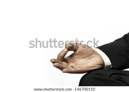 Closeup of the hand of a businessman relaxing in lotus position on a yoga exercise - stock photo