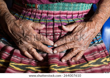 closeup of the hands of a very old mayan woman  - stock photo