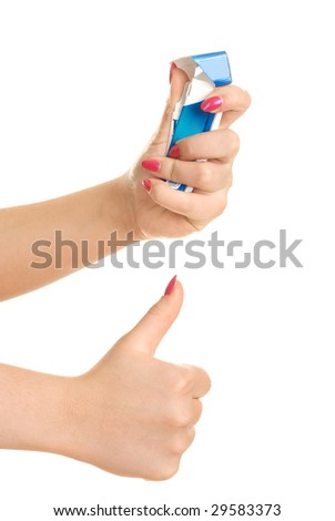 closeup of the hands of a young woman rumpling a pack of cigarettes and her thumb up