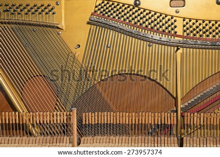 closeup of the inside of an old piano - stock photo
