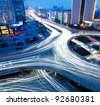 closeup of the light trails on grade separation bridge - stock photo
