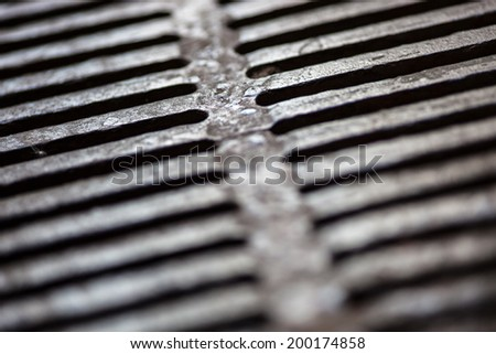 Closeup of the metal drain grate surface - stock photo