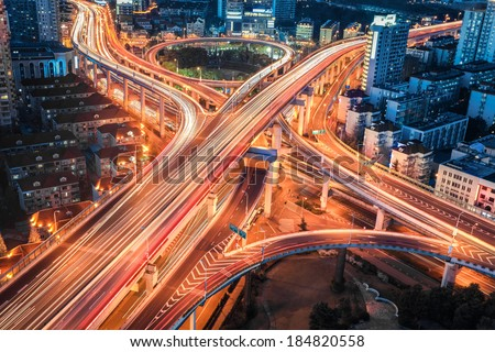 closeup of the modern city viaduct junction at night in shanghai  - stock photo