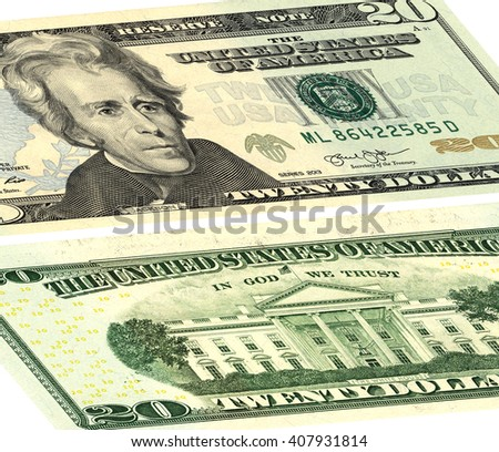 closeup of the obverse and reverse sides of the banknote in a twenty dollars isolated on white with Clipping Path.