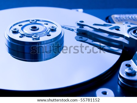Closeup of the platters and read/write head of a computer hard drive