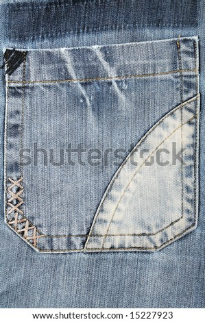 Closeup of the pocket of the blue jeans - stock photo