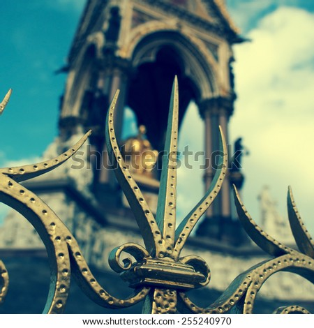 closeup of the railings at the Albert Memorial in London, United Kingdom, seen blurred in the background, with a filter effect - stock photo