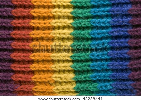 Closeup of the texture of a rainbow scarf