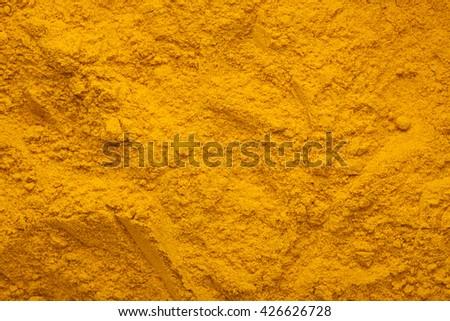 Closeup of the texture of turmeric powder - stock photo