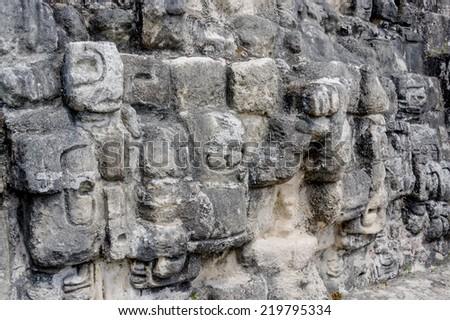 closeup of the tikal mayan ruins of ancient city in guatemala rainforest - stock photo
