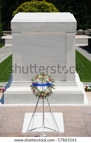 Closeup of the Tomb of the Unknown Soldier with a garland standing in front - stock photo