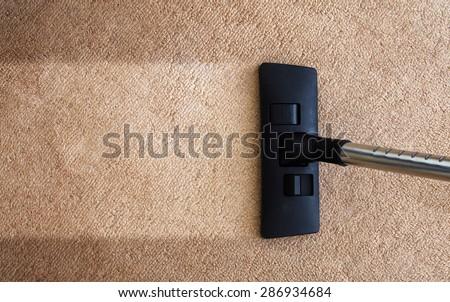 closeup of the vacuum on the carpet - stock photo