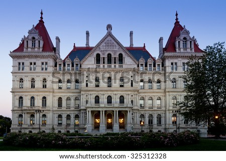 Closeup of the west facade of the State Capitol Building of New York, Albany after sunset - stock photo